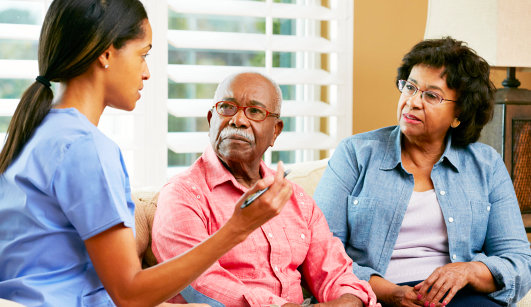 caregiver and old couple having discussion