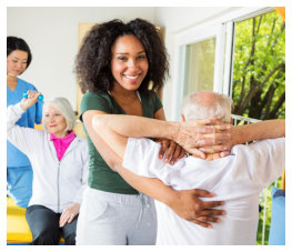 caregiver assisting senior with the exercise
