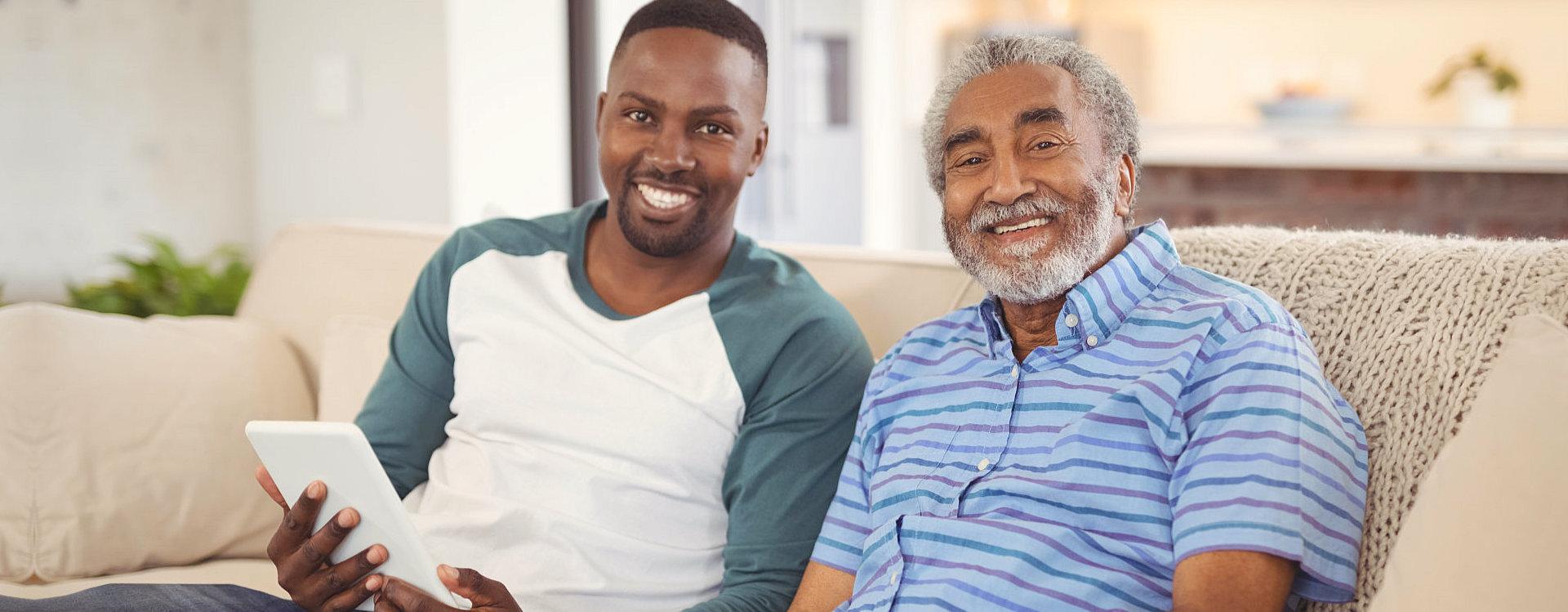 senior and caregiver smiling