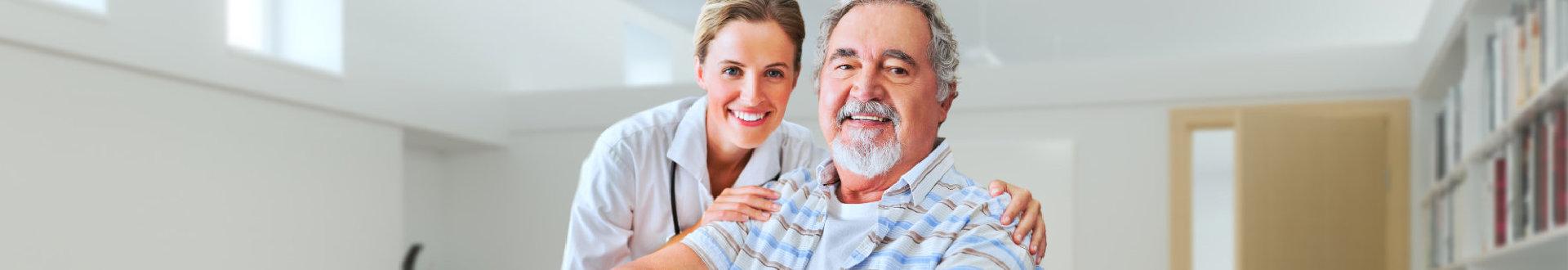 senior man and his caregiver smiling