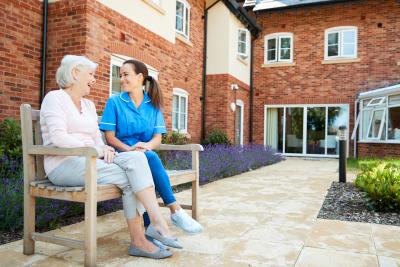 caregiver and a senior outside