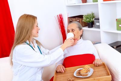 nurse helping senior eating