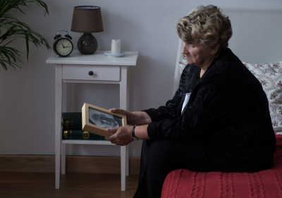 senior holding a picture frame
