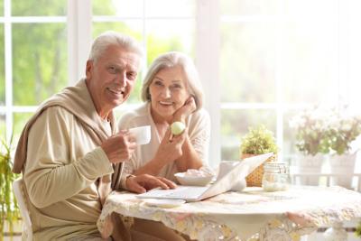 Beautiful elderly couple having breakfast
